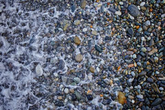 Sea waves on the rocky shore. Of the beach in winter royalty free stock photos