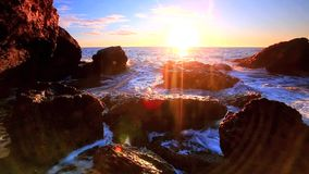 Sea waves on rocky shore. In sunrise time stock video footage