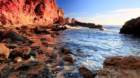 Sea waves and rocky shore stock video