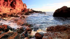 Sea waves and rocky shore stock video footage