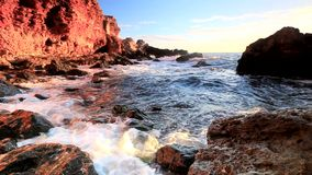 Sea waves and rocky shore stock footage