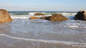 Sea waves on the rocky shoreline stock footage