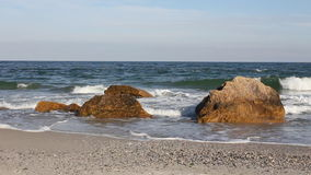 Sea waves on the rocky shoreline Stock Images