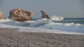 Sea waves on the rocky shoreline Full HD stock video footage