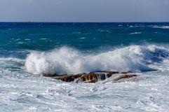 Sea waves rolling on stones Stock Photography