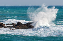 Sea waves rolling on stones Royalty Free Stock Images
