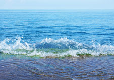Sea waves rolls on a breakwater Royalty Free Stock Images