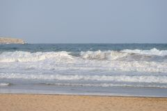 Sea waves running to the beach Stock Photography