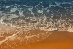 Sea waves and sand Stock Images