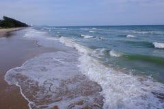 Sea waves on sand beach Royalty Free Stock Image
