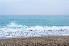 Sea, waves, sand. Brown sand, waves, turquoise sea. The Black Sea, Sudak Bay, Crimea stock photos