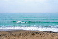 Sea, waves, sand. Brown sand, waves, turquoise sea. The Black Sea, Sudak Bay, Crimea royalty free stock photos