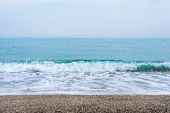 Sea, waves, sand. Brown sand, waves, turquoise sea. The Black Sea, Sudak Bay, Crimea stock photography
