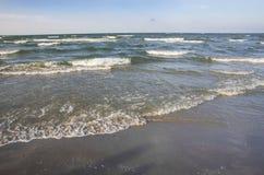 Sea waves on sand Stock Photo