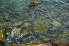 Sea, waves, sand and stones. Saving screen marine landscape. sea waves and stones Royalty Free Stock Image
