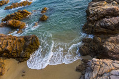 Sea, waves, sand and stones Royalty Free Stock Image