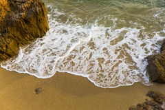 Sea, waves, sand and stones Stock Image