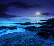 Sea waves on the sandy beach at night Stock Images
