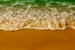 Sea waves on the sandy beach Royalty Free Stock Image