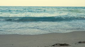 Sea waves on the seaside at the sunset. Vacation and relax stock video footage