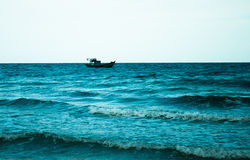 Sea with waves and ship on horizon Stock Images