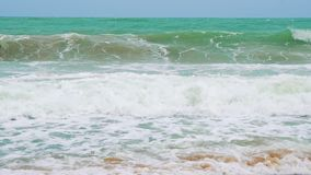 Sea waves slowly breaking against a sandy beach on a tropical island, slow motion.  stock footage