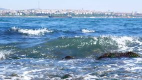 Sea waves. Sparks on the sea wave and boat on the horizon stock video footage