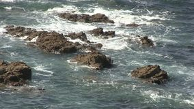 Sea waves splashing over rocks. Royalty Free Stock Photos