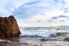 Sea Waves Splashing on Shore and Rock Island Royalty Free Stock Photo