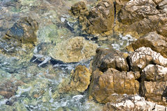 Sea waves splashing stones Stock Photography