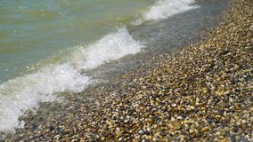 Sea Waves and the Stone Beach. In Summer Day. Holidays and Vacation Concept stock video