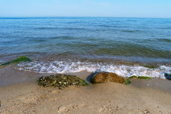 Sea, waves and stones Royalty Free Stock Photo