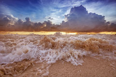 Sea waves on the sunset cloudy sky background. Stormy sea waves on the sunset cloudy sky background Stock Photos