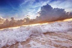 Sea waves on the sunset cloudy sky background Royalty Free Stock Photos