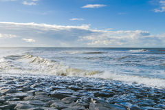 Sea waves throw themselves on the rocks Royalty Free Stock Image