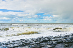 Sea waves throw themselves on the rocks Royalty Free Stock Images