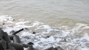 Sea waves and tsunami barrier of tetrapods. A sea waves and tsunami barrier of tetrapods stock video footage