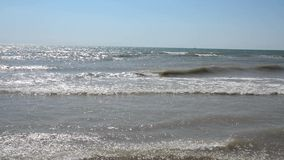 Sea waves video. Sea waves getting closer and closer to the shore in a windy day stock footage