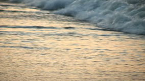 Sea waves wash the sand on the shore. Dim light in the evening. Dawn. Slowmotion stock video