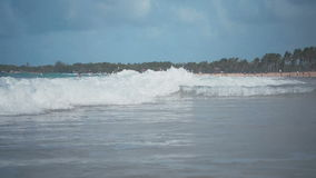 The sea waves is washed the resort beach. In the daytime stock footage
