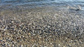 Sea waves washes pebble beach. Background stock footage