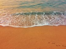 Sea waves on yellow sand beach. Stock Photography