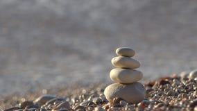 Sea waving overturn little stone pyramid from beach, destroin construction. Sea waving overturn little stone pyramid from beach, destroy construction, UHD 4K stock footage