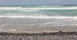 Sea waving in tropical beach of Lanzarote Island stock footage