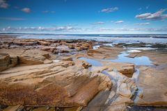 Sea Weathered Rocks at Druridge Bay. Druridge Bay is a seven mile long beach in Northumberland between Amble to the north and Cresswell to the south Royalty Free Stock Photos