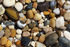 sea wet pebbles royalty free stock photo