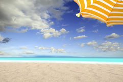 On the sea whit umbrella. Fantasticf deserted beach with umbrella orange and blue sea royalty free stock photo