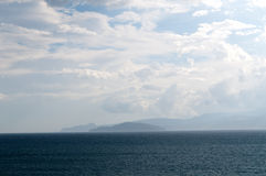 Sea and white clouds Stock Images
