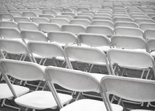 Sea of White Plastic Chairs Royalty Free Stock Image
