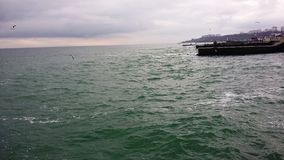 Sea in winter. Cold water tough waves beating on the pier royalty free stock photos